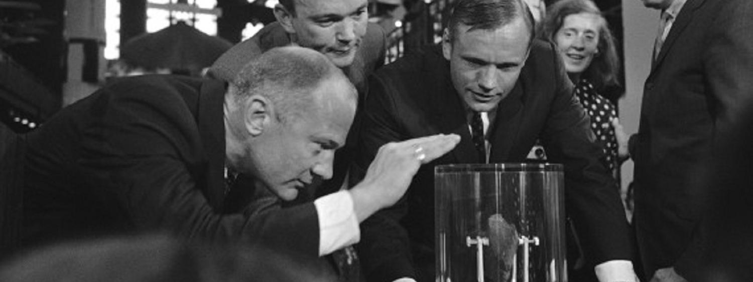 Apollo 11 Crew looks at Apollo 16 Moon Rock