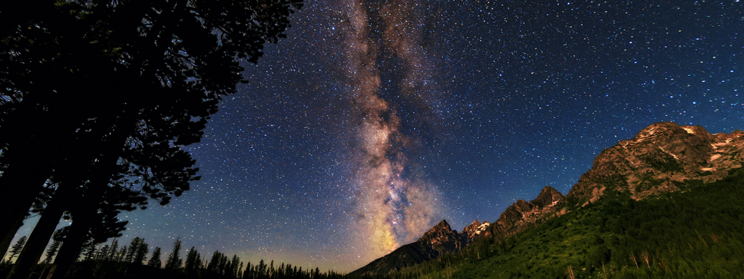 Photo of the Milky Way in the mountains with a lake.