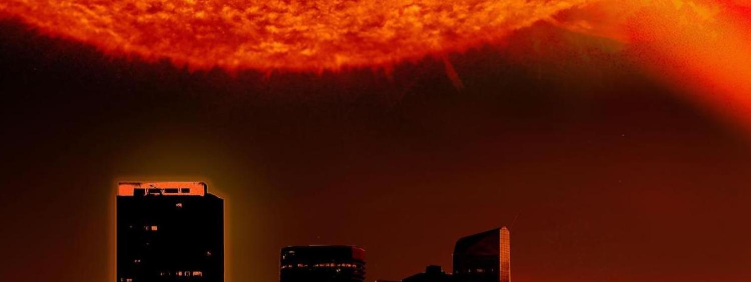 Still image from the film with a close up stellar flare over a city