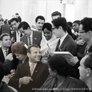 Photo of Yuri Gagarin signing autographs at a youth conference with Valentina Tereshkova, the first woman in space