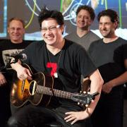 Band photo of Big Head Todd & the Monsters playing at NASA JSC in Mission Control