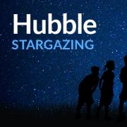 Hubble Stargazing banner graphic with silhouettes of people looking through a telescope in a grassy field