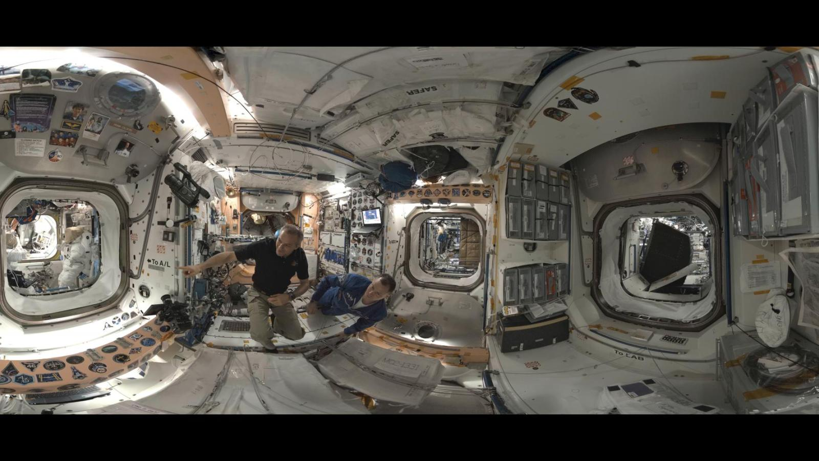 360 degree image of two astronauts working aboard the ISS