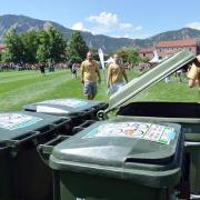 Student using a recycling bin