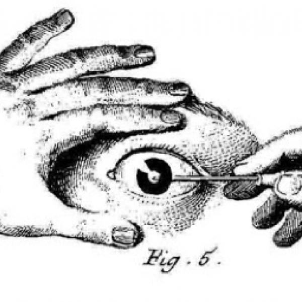 image of a hand painting its own eye