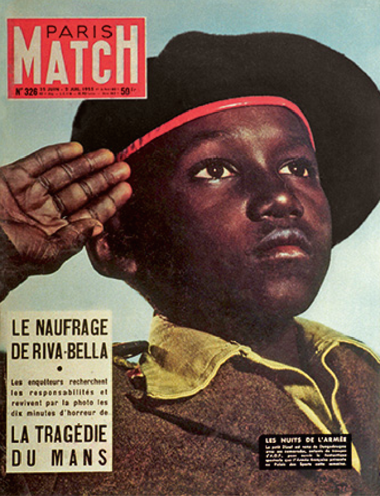 Picture of a Paris magazine cover that shows a young black person saluting