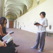 Professor Suzanne Magnanini speaking to her study abroad class in Italy