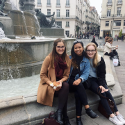 Students at a fountain in France