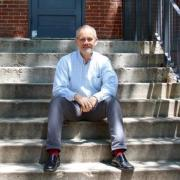 Picture of Valerio Ferme on steps of Old Main