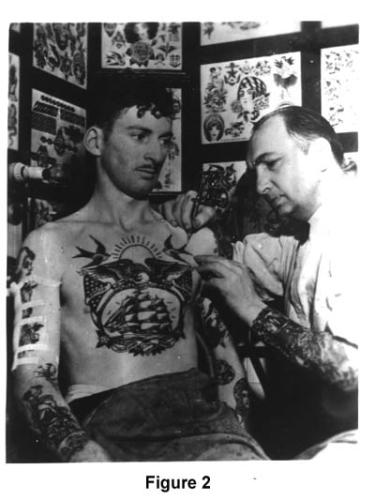 Tattooing on arms and battleship on chest photo