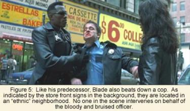 """Like his predecessor, Blade also beats down a cop. As indicated by the store front signs in the background, they are located in an """"ethnic"""" neighborhood. No one in the scene intervenes on behalf of the bloody and bruised officer"""