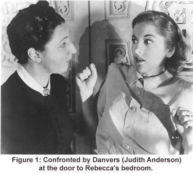 Confronted by Danvers (Judith Anderson) at the door to Rebecca's bedroom.