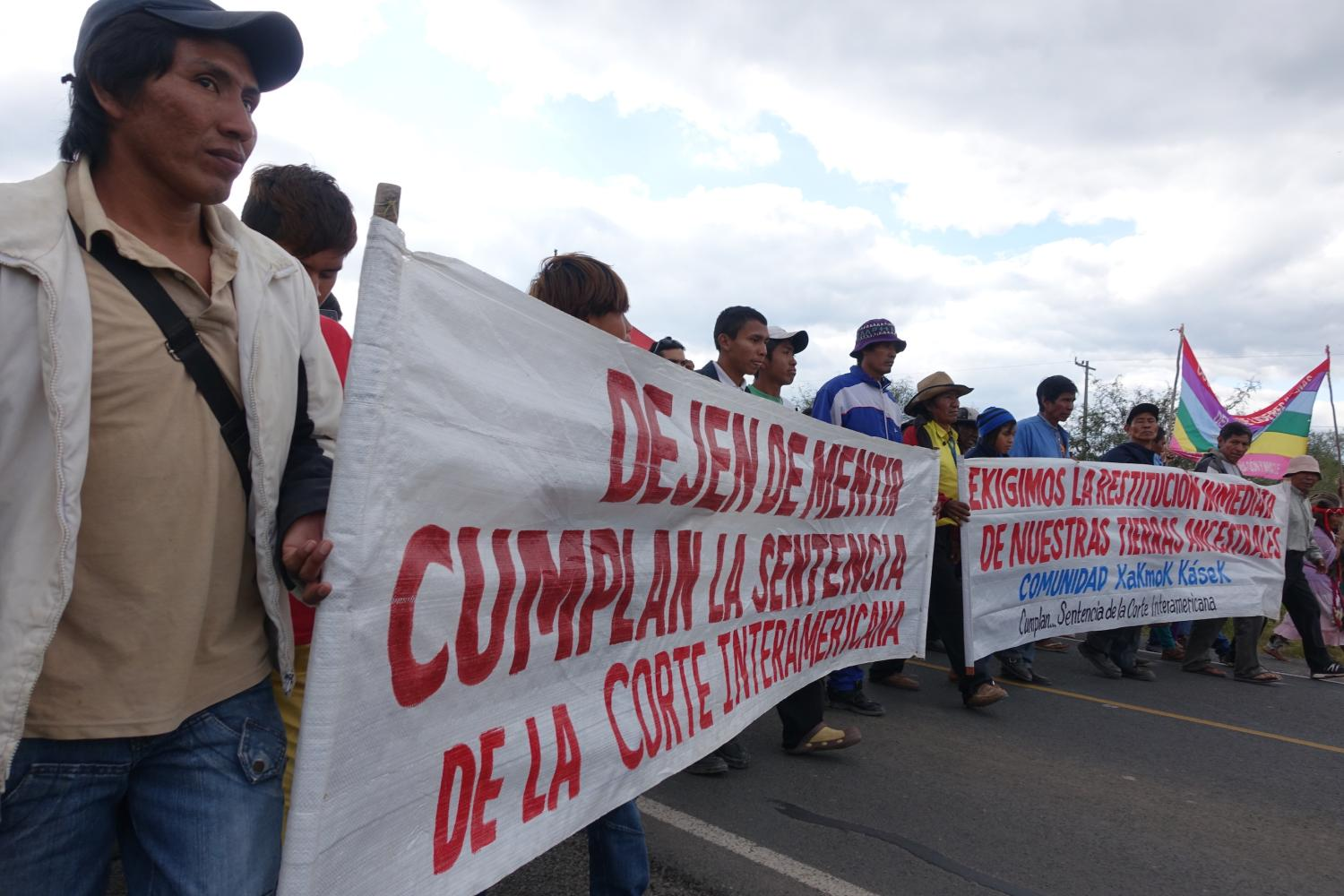 Protesters marching in the street, holding banners