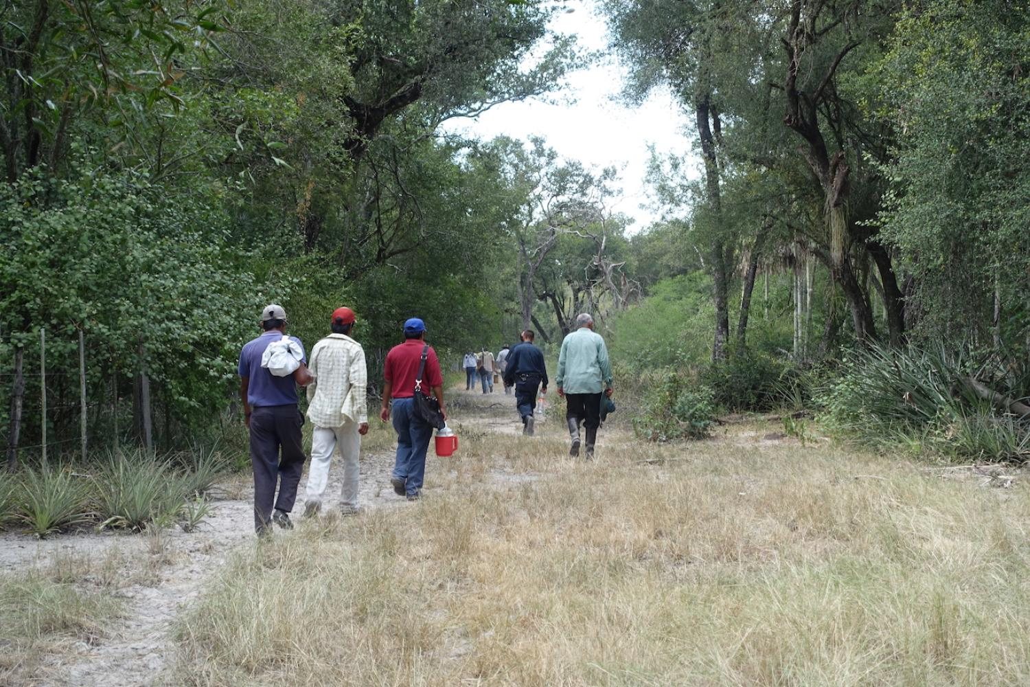 People walking a trail on the Yakye Axa property
