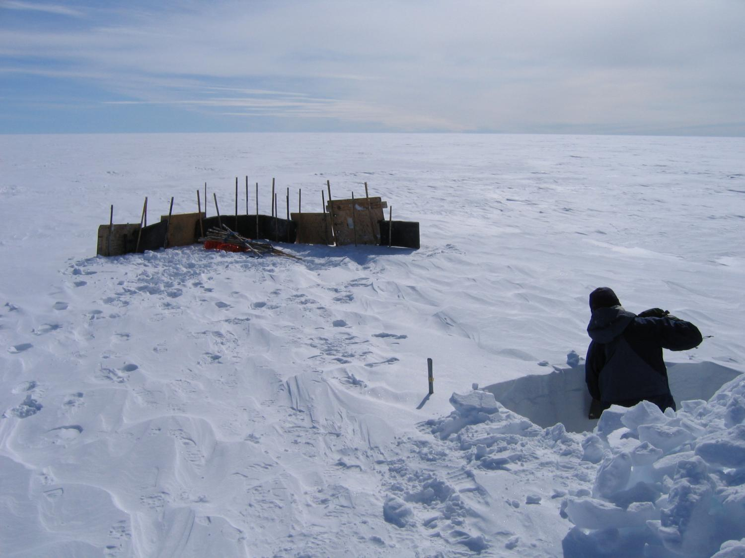 Observing sastrugi development on the Greenland Ice Sheet. May 2005.  Photo: Noah Molotch (Geography & INSTAAR, CU-Boulder).