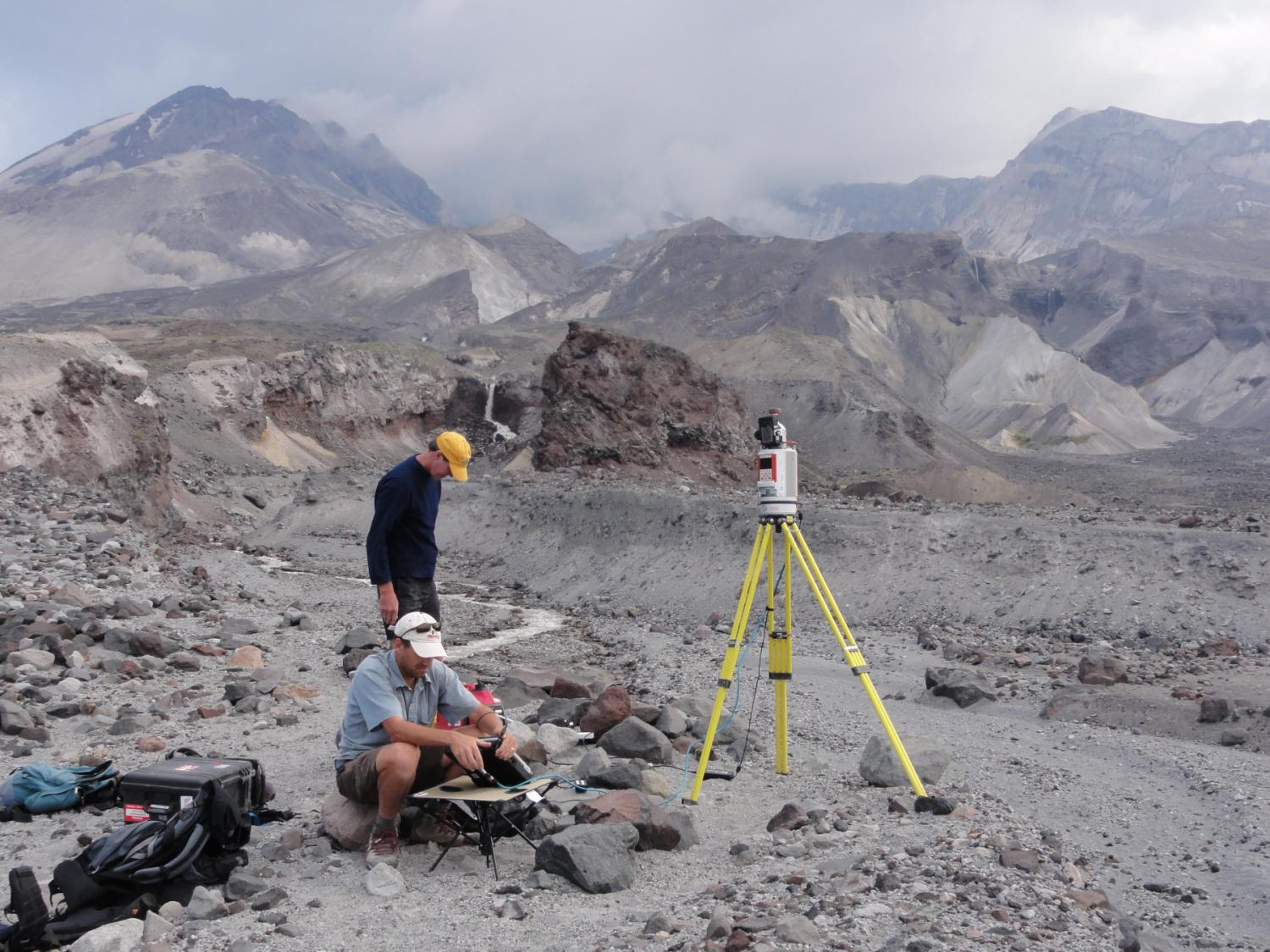 Faculty member John Pitlick and UNAVCO engineer Jim Normadeau using ground-based LiDAR to scan the topography of the North Fork Toutle River near Mount St. Helens, WA. August, 2010.  Photo: Chuck Meertens (UNAVCO, Boulder)