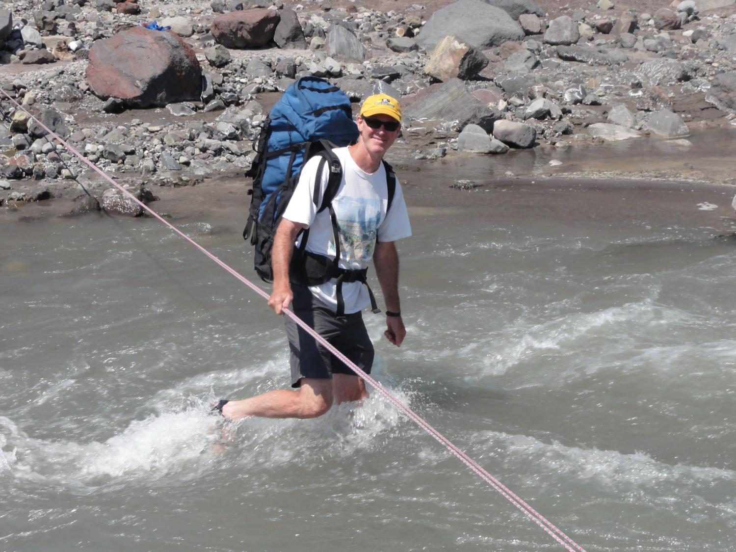 Faculty member John Pitlick crossing the North Fork of the Toutle River near Mount St. Helens, WA. August 2010