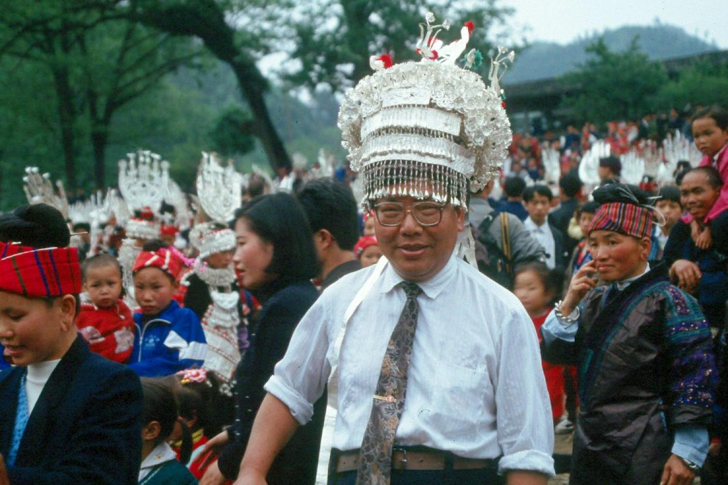 A Chinese tourist dons a Miao silver headdress at the Sister's Rice Festival