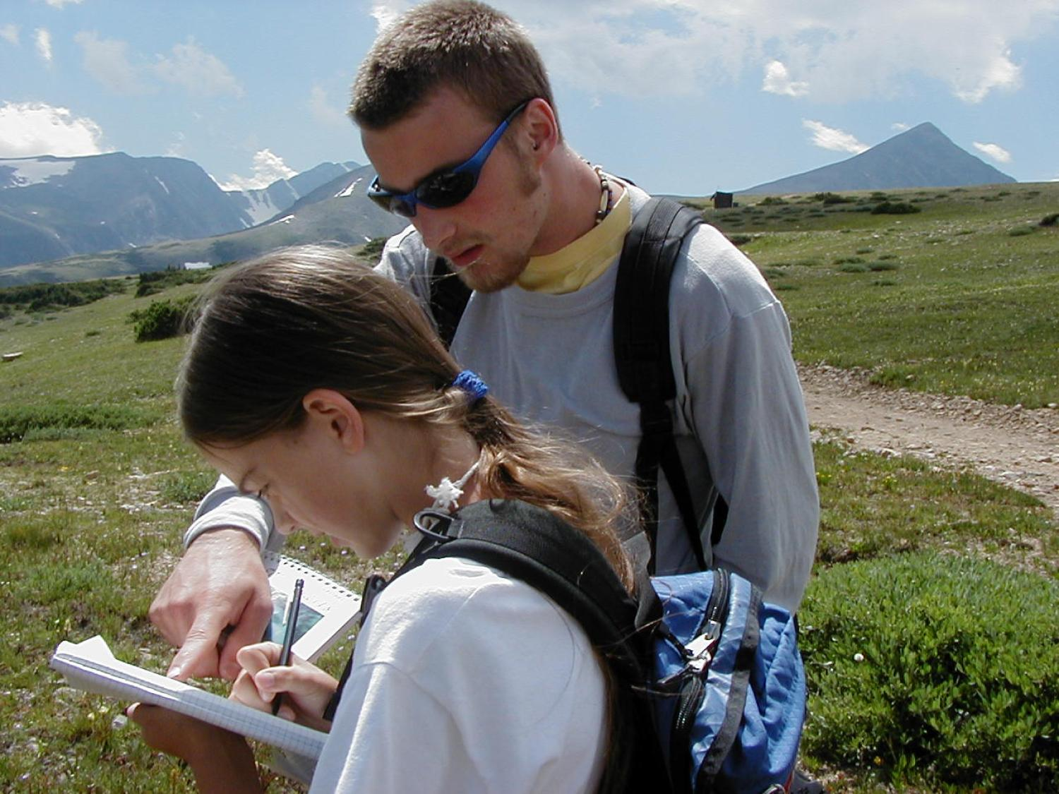 An elementary school student learns about treeline processes and alpine tundra at an elevation of about 11,400' near Ward, Colorado. August 2000.