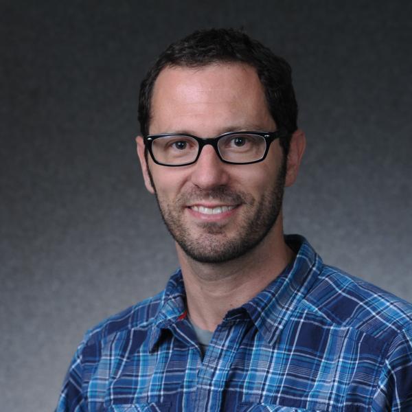 Gregory Simon headshot