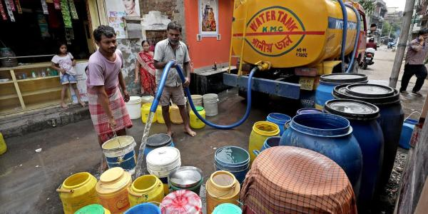 Residents collect drinking water from a municipal tanker in Kolkata, India