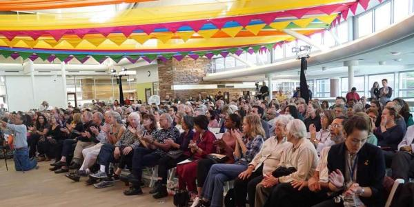 An audience sitting in chairs