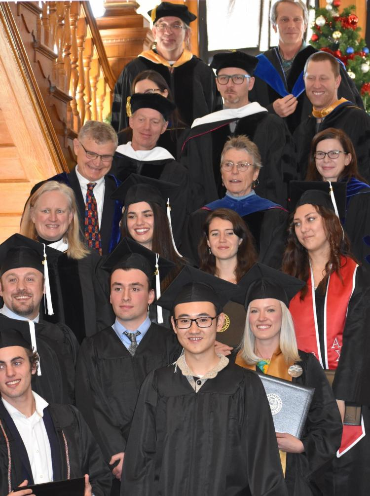 Group of students and faculty in caps and gowns