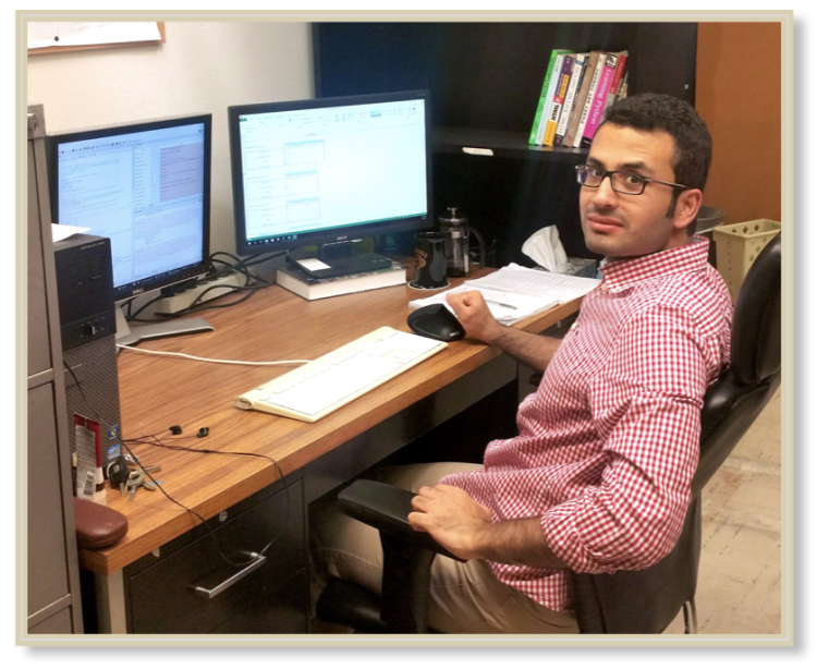 Hamid sitting at his desk