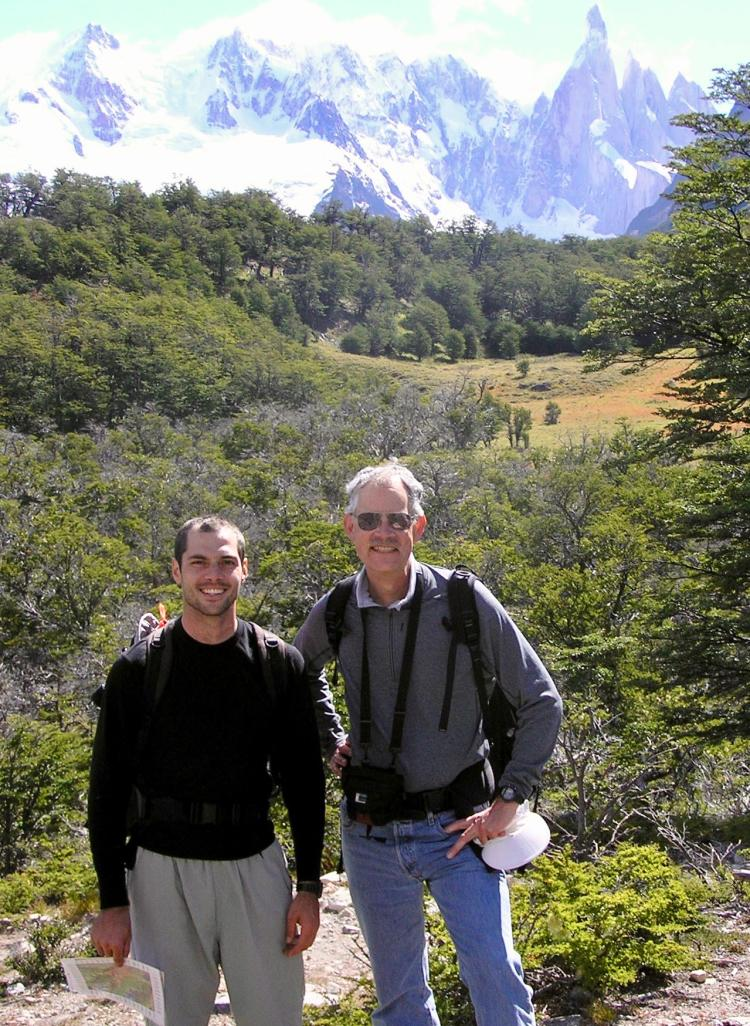 2 men posing in front of mountain landscape in Argentina