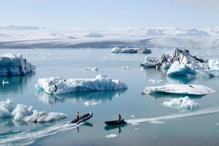 Boats near Arctic ice and water