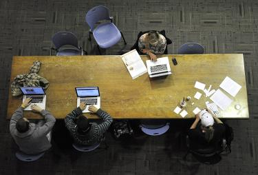 Overhead view of students studying at a large table