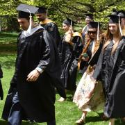 Students walking in graduation gowns