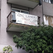 "Apartment complex with sign saying, ""Got land? Thank an Indian"""