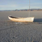 old boat on a dry lake bed