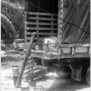 Back end of truck with items laying on the ground