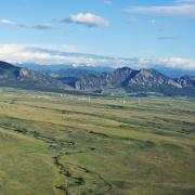 Aerial shot of Rocky Flats with mountain backdrop