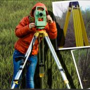 Woman using surveying equipment