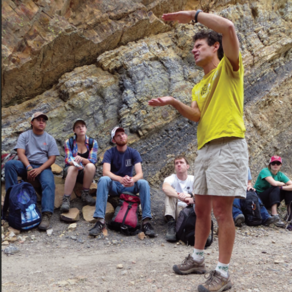 Lon Abbott Explaining a concept to graduate students in the field