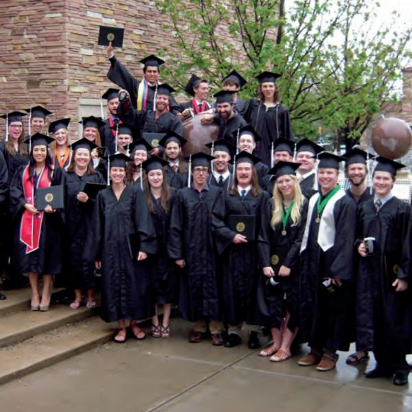 A group of recent graduates at graduation