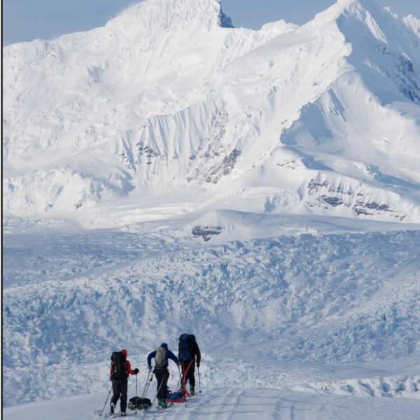 a team of people working at a snow covered field site