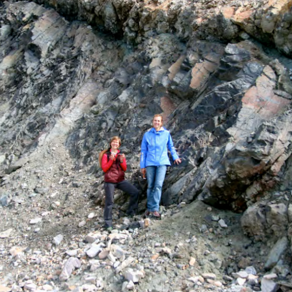 A small group looking at an outcrop