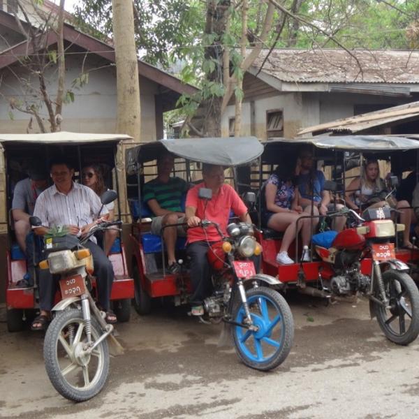Tuk Tuks in the market in Burma