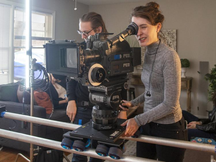 Kate behind a film camera