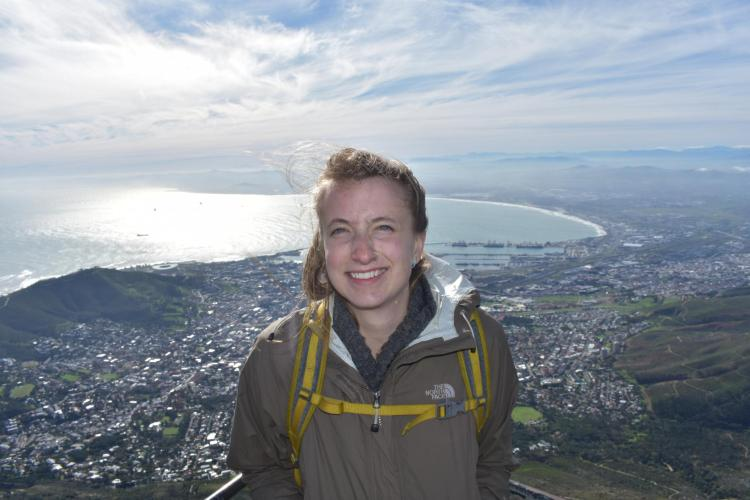 Emily standing high above a town and body of water