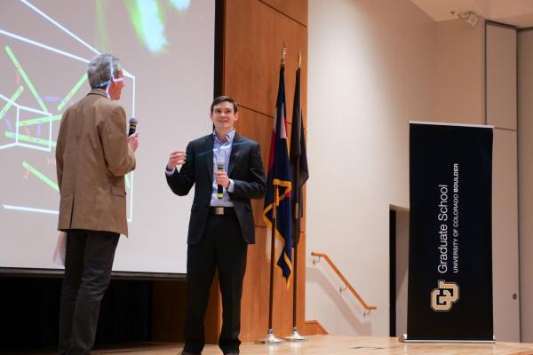 Adam talking to emcee Bud Coleman at the 3MT competition