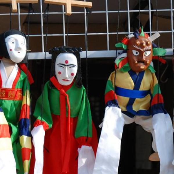 People in costume for an Asian festival