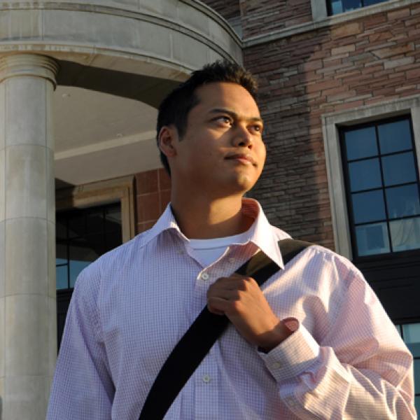 Man standing outside Koelbel building