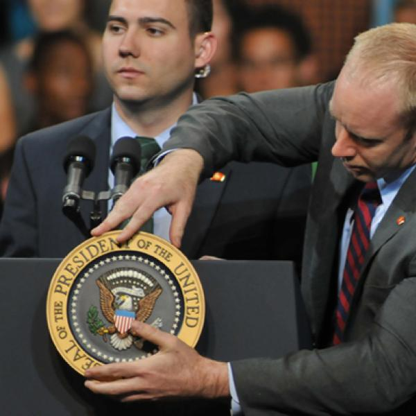 Preparing a lectern for a political speech