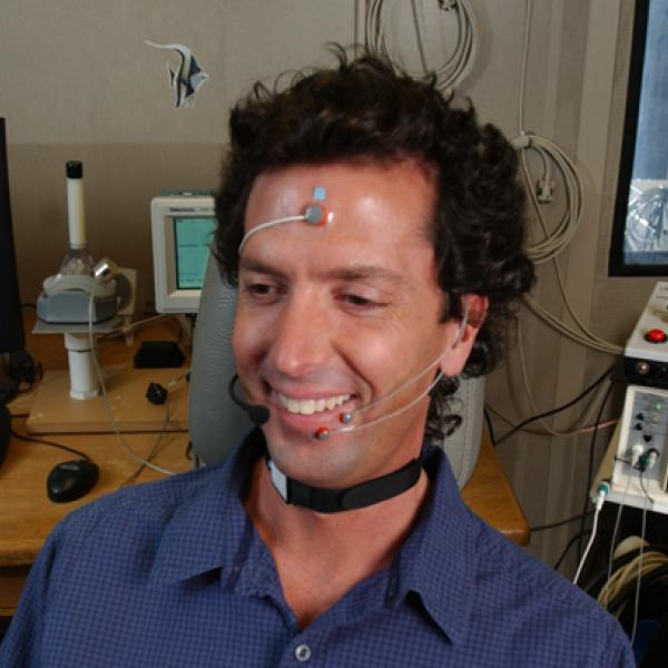 Man hooked up to devices for speech and hearing