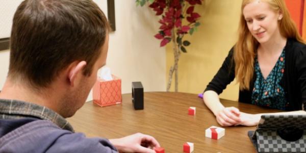 Graduate student Rachel Thayer provides cognitive testing for homeless client at CU Boulder's Brain Behavior Clinic.
